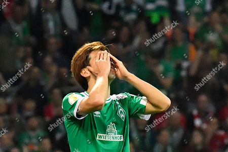 Bremen's Yuya Osako reacts after missing a chance to score during the German soccer cup, DFB Pokal, semifinal match between Werder Bremen and Bayern Munich at the Weser stadium in Bremen, Germany