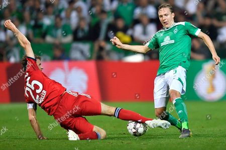 Bayern's Thomas Mueller, left, and Bremen's Ludwig Augustinsson, right, vie for the ball during the German soccer cup, DFB Pokal, semifinal match between Werder Bremen and Bayern Munich at the Weser stadium in Bremen, Germany