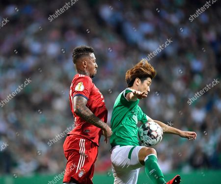 Bremen's Yuya Osako, right, and Bayern's Jerome Boateng, left, vie for the ball during the German soccer cup, DFB Pokal, semifinal match between Werder Bremen and Bayern Munich at the Weser stadium in Bremen, Germany