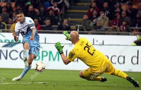 Milan's goalkeeper Jose Manuel 'Pepe' Reina (R) and Lazio's Joaquin Correa in action during the Italian Coppa Italia semifinal second leg soccer match between AC Milan and SS Lazio at the Giuseppe Meazza stadium in Milan, Italy, 24 April 2019.