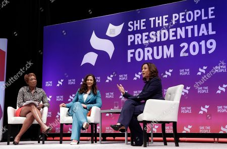 Moderator Joy Reid and She the People founder Aimee Allison listen as Democratic presidental candidate Sen. Kamala Harris, D-Calif., answers questions during a presidential forum held by She The People on the Texas State University campus, in Houston