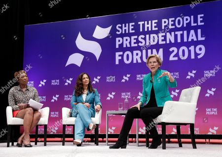 Stock Photo of Moderator Joy Reid and She the People founder Aimee Allison listen as Democratic presidential candidate Sen. Elizabeth Warren, D-Mass., answers questions during a presidential forum held by She The People on the Texas State University campus, in Houston