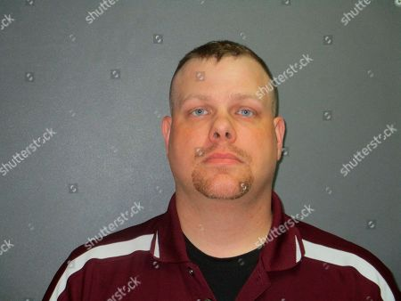 This undated photo provided by the Llano County Sheriff's Office shows Russell Butler. The Texas police officer is charged with murder for fatally shooting a man who ran over his foot. Burnet Police Chief Paul Nelson says former Patrol Sgt. Butler also had been fired for violating the department's use of force policy. KVUE television reports Butler was charged, with murder and three counts of aggravated assault by a public servant for the killing of 25-year-old Brandon Michael Jacque in the city about 55 miles (88 kilometers) northwest of Austin