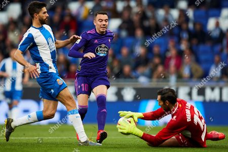 Espanyol's goalkeeper Diego Lopez (R) in action against Celta de Vigo's Iago Aspas (2-L) during the Spanish LaLiga soccer match between Espanyol and Celta de Vigo at the RCD Stadium in Barcelona, Spain, 24 April 2019.