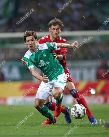 24.04.2019, Football DFB Pokal 2018/2019, semi final , SV Werder Bremen -  FC Bayern Muenchen, Weserstadium Bremen. (L-R) Yuya Osako (Werder Bremen)  -  Leon Goretzka (Bayern Muenchen)