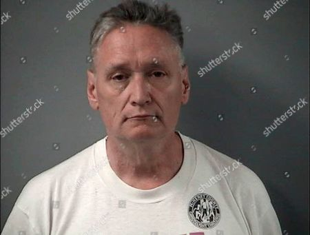 "In this is a booking photo provided by the Crystal Lake Police Department of Andrew Freund Sr, who along with his wife Joann Cunningham, have been charged with murder and other charges in the death of their missing son Andrew ""AJ"" Freund. Authorities say they have found what they believe is the body of the 5-year-old boy who went missing last week. Crystal Lake police Chief James Black said at a news conference Wednesday that police dug up what they believe is Freund's body in a field and that it was wrapped in plastic"