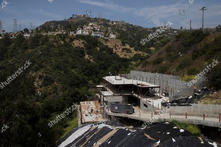 A homer under construction is seen in the Chevy Chase Canyon neighborhood of Glendale, Calif. The city of Glendale straddles the Verdugo Mountains with neighborhoods, schools, and hiking trails carved into its base. The city's 2008 emergency plan identified them as potential brush fire zones