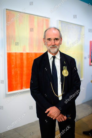 Stock Image of President of the Royal Academy Christopher le Brun in front of some of his prints.