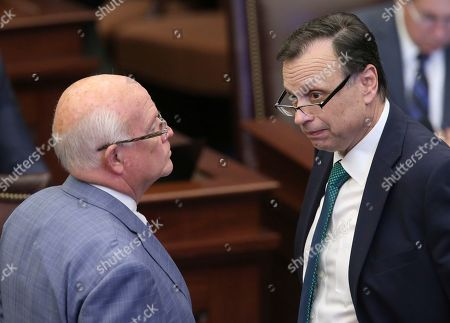 Sen. Tom Lee, R-Brandon, right, confers with Sen. Dennis Baxley, R-Ocala, during session, in Tallahassee, Fla