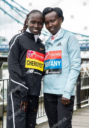 Vivian Cheruiyot and Mary Keitany seen during the Elite women's photocall ahead of Sunday's London Marathon at the Tower Hotel in London.