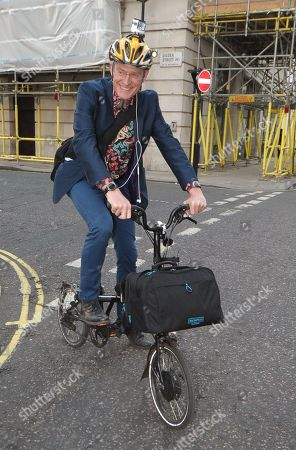 Jeremy Vine leaves the BBC Radio 2 studios on his bike with his trusty GoPro