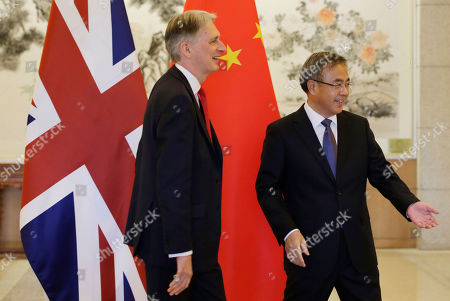 Britain's Chancellor of the Exchequer Philip Hammond (L) meets Chinese Vice Premier Hu Chunhua (R) at the Diaoyutai State Guesthouse in Beijing, China, 25 April 2019. Hammond is in Beijing to attend the Belt and Road forum.