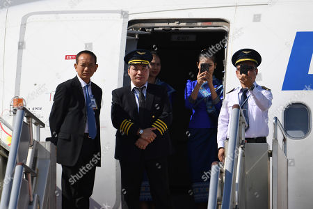 Crew on the plane which carried Laos President Bounnhang Vorachith (not pictured) take photos of the honor guard after Vorachith's arrival at Beijing International airport prior to the start of the Belt and Road Forum in Beijing, China, 25 April 2019. Leaders from 37 countries have been converging in Beijing for the Belt and Road Forum on 25 April.