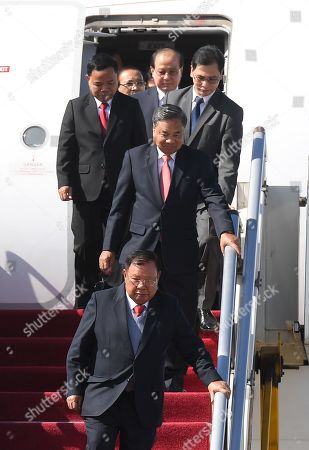 Laos President Bounnhang Vorachith (bottom) arrives at Beijing airport ahead of the Belt and Road Forum in Beijing, China, 25 April 2019. Leaders from 37 countries have been converging in Beijing for the Belt and Road Forum on 25 April.
