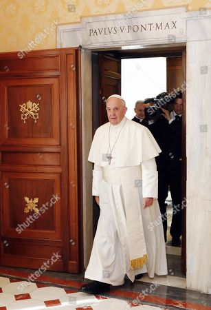 Pope Francis arrives to meet with Latvian President Raimonds Vejonis at the Vatican