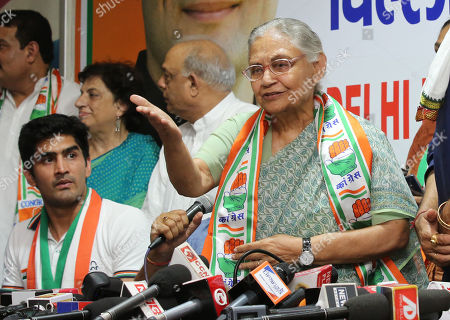 Indian Boxer and Indian National Congress(INC) candidates Vijender Singh (L) and Sheila Dikshit (R) attend a press conference in New Delhi, India, 25 April 2019. Vijender Singh is a Indian National Congress(INC) candidate for South Delhi constituency and Sheila Dikshit is a Indian National Congress(INC) candidate for North East Delhi constituency for the upcoming general elections for India's 545-member lower house of parliament, or Lok Sabha, that is held every five years.