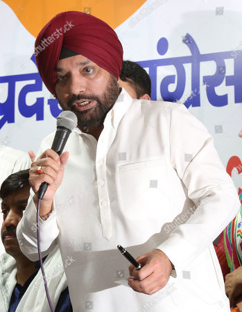 Stock Image of Indian National Congress (INC) candidate Arvinder Singh Lovely speaks during a press conference in New Delhi, India, 25 April 2019. Vijender Singh is a Indian National Congress(INC) candidate for South Delhi constituency and Sheila Dikshit is a Indian National Congress(INC) candidate for North East Delhi constituency for the upcoming general elections for India's 545-member lower house of parliament, or Lok Sabha, that is held every five years.