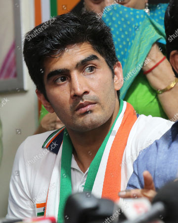 Stock Picture of Indian Boxer and Indian National Congress(INC) candidate Vijender Singh attends a press conference in New Delhi, India, 25 April 2019. Vijender Singh is a Indian National Congress(INC) candidate for South Delhi constituency and Sheila Dikshit is a Indian National Congress(INC) candidate for North East Delhi constituency for the upcoming general elections for India's 545-member lower house of parliament, or Lok Sabha, that is held every five years.