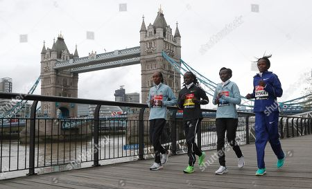 Gladys Cherono. Vivian Cheruiyot, Mary Keitany, Brigid Ksgei. Women's elite runners from the left Kenya's Gladys Cherono, Kenya's Vivian Cheruiyot, Kenya's Mary Keitany and Ethiopia's Brigid Ksgei gently jog for the cameras past Tower Bridge during a photo call for the London Marathon in London, . The 39th London Marathon takes place Sunday April 28