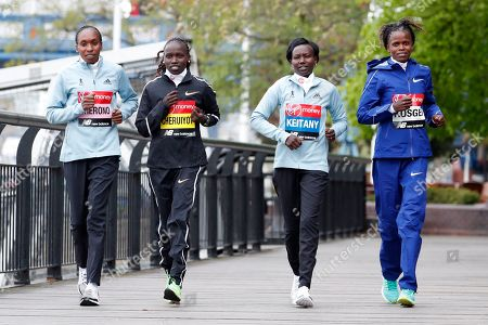 Gladys Cherono. Vivian Cheruiyot, Mary Keitany, Brigid Ksgei. Women's elite runners from the left Kenya's Gladys Cherono, Kenya's Vivian Cheruiyot, Kenya's Mary Keitany and Ethiopia's Brigid Ksgei gently jog for the cameras during a photo call for the London Marathon in London, . The 39th London Marathon takes place Sunday April 28