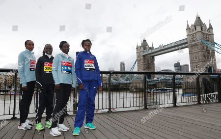 Gladys Cherono. Vivian Cheruiyot, Mary Keitany, Brigid Ksgei. Women's elite runners, from left, Kenya's Gladys Cherono, Kenya's Vivian Cheruiyot, Kenya's Mary Keitany and Ethiopia's Brigid Ksgei pose for the cameras with Tower Bridge in the background during a photo call for the London Marathon, in London, . The 39th London Marathon takes place Sunday April 28