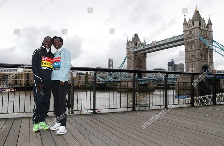 Vivian Cheruiyot, Mary Keitany. Women's elite runners Vivian Cheruiyot, left, and Mary Keitany, both from Kenya, pose for the cameras during a photo call for the London Marathon in London, . The 39th London Marathon takes place Sunday April 28