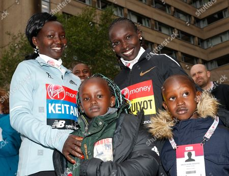 Vivian Cheruiyot, Mary Keitany. Women's elite runners Kenya's Mary Keitany, left and her compatriot Vivian Cheruiyot smile for the camera following a photo call for the London Marathon in London, . The 39th London Marathon takes place Sunday April 28