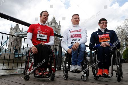 Marcel Hug, David Weir, Daniel Romanchuk. From left, Elite men's wheelchair participants Switzerland's Marcel Hug, Britain's David Weir and Daniel Romanchuk of the United States pose for the cameras during a photo call for the London Marathon in London, . The 39th London Marathon takes place Sunday April 28