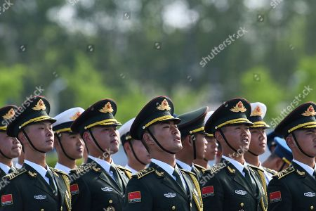Members of a Chinese military honor guard rehearse before the arrival of Tajikistan's President Emomali Rahmon at Beijing airport