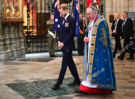 Stock Picture of Britain's Prince Harry, the Duke of Sussex and the Dean of Westminster Dr John Hall attend the Anzac Day Service of Commemoration and Thanksgiving at Westminster Abbey, in London, . Anzac Day has been commemorated in London since the first anniversary of the Anzac landings at Gallipoli in 1916, when King George V attended a service at Westminster Abbey and more than 2,000 Australian and New Zealand troops marched through the streets