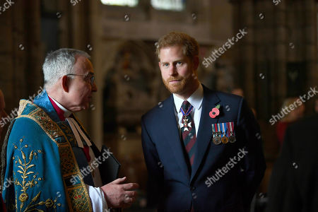Stock Picture of Britain's Prince Harry, the Duke of Sussex listens to theDean of Westminster Dr John Hall as he leaves the Anzac Day Service of Commemoration and Thanksgiving at Westminster Abbey, in London, . Anzac Day has been commemorated in London since the first anniversary of the Anzac landings at Gallipoli in 1916, when King George V attended a service at Westminster Abbey and more than 2,000 Australian and New Zealand troops marched through the streets