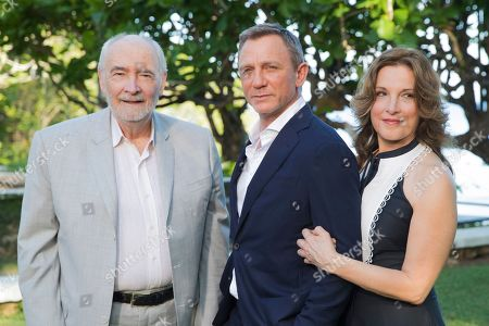 Michael G Wilson, Barbara Broccoli, Daniel Craig. Producers Michael G Wilson, left, and Barbara Broccoli, right, pose for photographers with actor Daniel Craig during the photo call of the latest installment of the James Bond film franchise, currently known as 'Bond 25', in Oracabessa, Jamaica