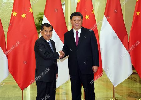 Chinese President Xi Jinping (R) shakes hands with Indonesia Vice President Jusuf Kalla (L) before the bilateral meeting of the Second Belt and Road Forum at the Great Hall of the People in Beijing, China, 25 April 2019. Beijing hosts the Second Belt and Road Forum for International Cooperation.