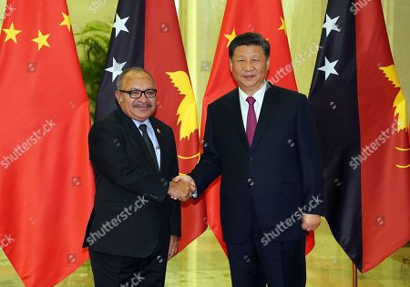 Chinese President Xi Jinping (R) shakes hands with Papua New Guinea Prime Minister Peter O'Neill (L) before the bilateral meeting of the Second Belt and Road Forum at the Great Hall of the People in Beijing, China, 25 April 2019. Beijing hosts the Second Belt and Road Forum for International Cooperation.