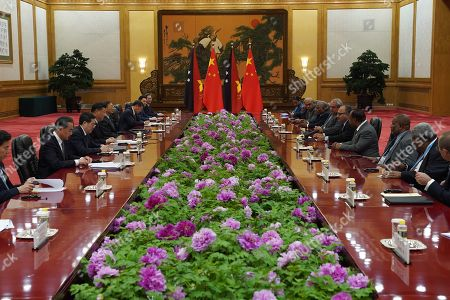 Stock Image of Chinese President Xi Jinping (L-C), Papua New Guinea Prime Minister Peter O'Neill (R-C) and delegations sit for a bilateral meeting at the Second Belt and Road Forum at the Great Hall of the People in Beijing, China, 25 April 2019. Beijing hosts the Second Belt and Road Forum for International Cooperation.