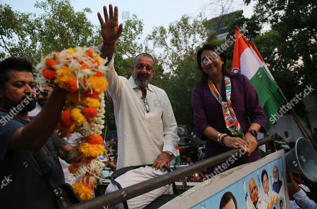 Sanjay Dutt, Priya Dutt. Bollywood actor Sanjay Dutt, center, waves during an election campaign for his sister and Congress party candidate Priya Dutt in Mumbai, India, . With 900 million of India's 1.3 billion people registered to vote, the Indian national election is the world's largest democratic exercise