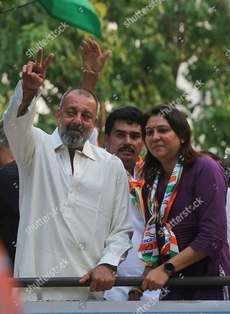 Stock Image of Sanjay Dutt, Priya Dutt. Bollywood actor Sanjay Dutt displays the victory symbol during an election campaign for his sister and Congress party candidate Priya Dutt in Mumbai, India, . With 900 million of India's 1.3 billion people registered to vote, the Indian national election is the world's largest democratic exercise