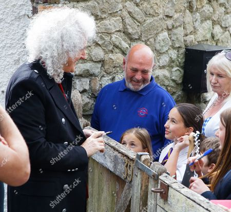Stock Picture of Brian May meets fans at Sir Patrick's former home