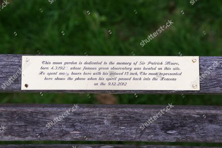 Stock Photo of Plaque on memorial bench