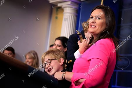 Huck Sanders, George Sanders, Sarah Huckabee Sanders, Mike Pence. White House press secretary Sarah Huckabee Sanders holding her children Huck Sanders, with eye glasses, and George Sanders, conducts a briefing for children of journalists and White House staff in the Brady press briefing room at the White House in Washington, to commemorate Take Our Daughters and Sons to Work Day