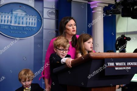 Sarah Sanders, Goerge Sanders, Huck Sanders, Scarlett Sanders. White House press secretary Sarah Sanders is joined at the podium with her children, George Sanders, left, Huck Sanders, center, and Scarlett Sanders, right, during a briefing at the White House in Washington, with children of White House staff and journalists. The briefing was part of activities for Take Our Daughters and Sons to Work Day at the White House