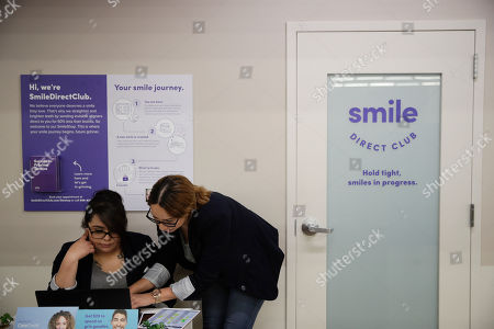 Jessica Buendia, Itzel Barrueta. Dental assistants Itzel Barrueta, left, and Jessica Buendia go over appointments at SmileDirectClub's SmileShop located inside a CVS store, in Downey, Calif. CVS Health is venturing into dental care with plans to offer the relatively new teeth-straightening service