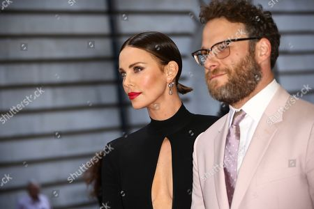 Stock Photo of Charlize Theron, Seth Rogan. Actors Charlize Theron, left, and Seth Rogan pose for photographers at the premiere of the film 'Long Shot' in London