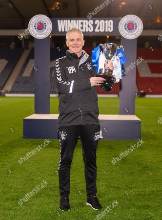 Rangers Youth Team Coach David McCallum celebrates with the Scottish Youth Team Cup after beating Celtic 3-2.