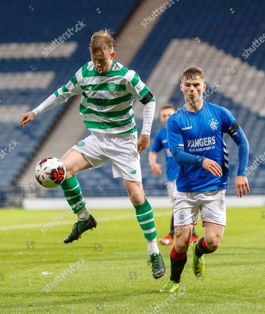 Stock Photo of Cameron Harper of Celtic controls the ball in front of Josh McPake of Rangers.