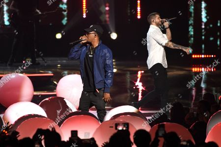 Stock Picture of MKTO, Malcolm David Kelley, Tony Oller. Malcolm David Kelley, left, and Tony Oller of MKTO perform at WE Day California at The Forum, in Inglewood, Calif