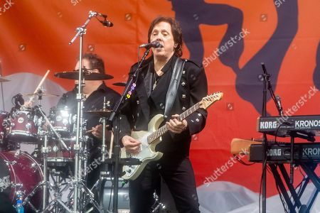 Stock Photo of John McFee of The Doobie Brothers performs at the New Orleans Jazz and Heritage Festival, in New Orleans