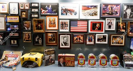 Pictures, games, and magazines on display in Andres Serrano's installation 'The Game: All Things Trump', a display of over 1,000 pieces of Donald Trump-related memorabilia and souvenirs collected by Serrano, in New York, New York, USA, 25 April 2019. The items in the installation, which Serrano purchased over the past year at auctions and on eBay, span from Trump's early days in the New York, to his days on television and up to the present day.