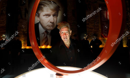 Stock Picture of Artist Andres Serrano poses for a portrait in his new installation 'The Game: All Things Trump', a display of over 1,000 pieces of Donald Trump-related memorabilia and souvenirs collected by Serrano, in New York, New York, USA, 25 April 2019. The items in the installation, which Serrano purchased over the past year at auctions and on eBay, span from Trump's early days in the New York, to his days on television and up to the present day.