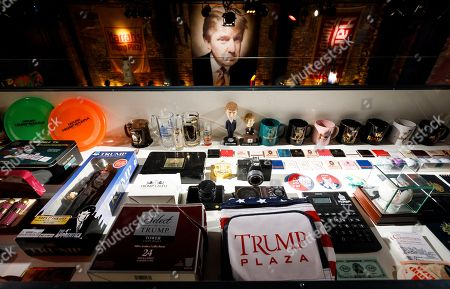 Stock Photo of Various branded Trump paraphernalia on display in Andres Serrano's installation 'The Game: All Things Trump', a display of over 1,000 pieces of Donald Trump-related memorabilia and souvenirs collected by Serrano, in New York, New York, USA, 25 April 2019. The items in the installation, which Serrano purchased over the past year at auctions and on eBay, span from Trump's early days in the New York, to his days on television and up to the present day.